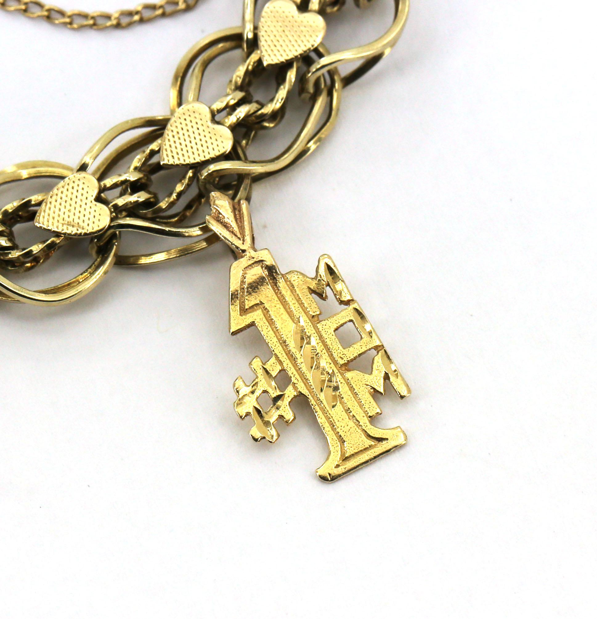Vintage 14k Gold Charm Bracelet: VINTAGE 14K YELLOW GOLD HEART MOTIF CHARM BRACELET W/ 4 3D